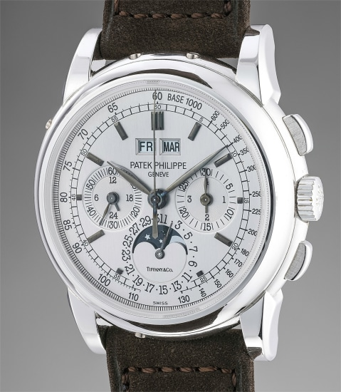 A very fine and extremely rare white gold perpetual calendar chronograph wristwatch with moonphases, Certificate and box, retailed by Tiffany & Co.