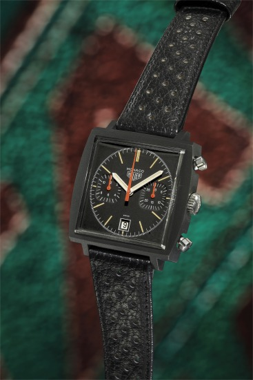 A very rare square shaped black PVD-coated stainless steel chronograph wristwatch with black dial, two subsidiary registers, date at 6 o'clock, orange chronograph hands, box, guarantee booklet and hang tag.