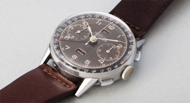 A very attractive and large stainless steel triple calendar chronograph wristwatch with two-tone black dial and vertical month and day indication