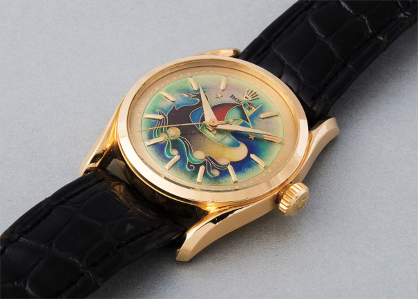 An extremely rare, important, and exquisitely preserved yellow gold wristwatch with cloisonné enamel dial depicting a caravel, accompanied by the original certificate