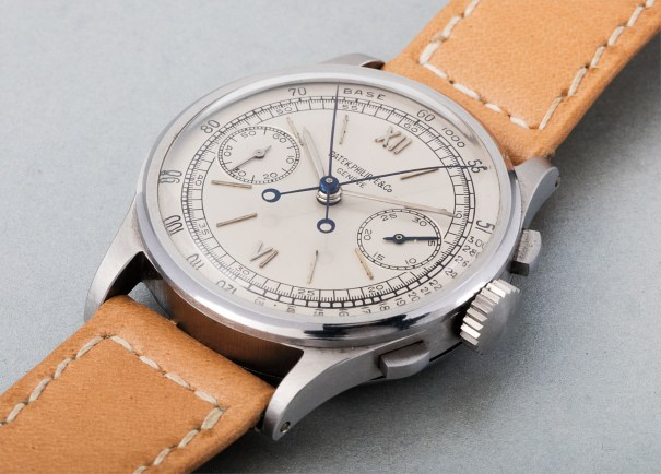 An extremely rare and highly important stainless steel split-seconds chronograph wristwatch with silvered dial, raised steel hour markers and tachometer scale