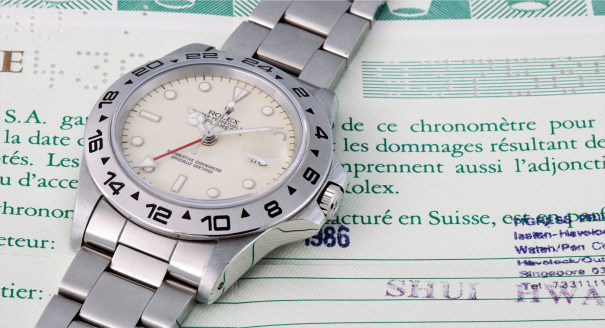 """A rare and attractive stainless steel wristwatch with centre seconds, dual time, bracelet and cream """"rail"""" dial"""