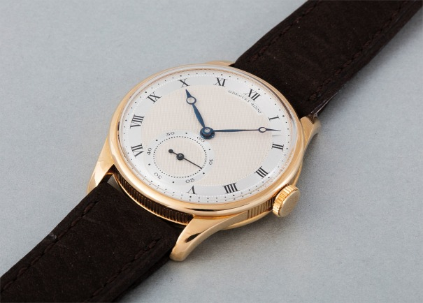 A very rare and attractive yellow gold wristwatch with two-toned silver and engine-turned dial
