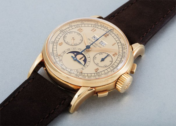 An extremely rare and highly important yellow gold perpetual calendar chronograph wristwatch with moon phases and champagne-colored dial