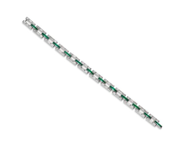 A Diamond, Emerald and Platinum Bracelet, Circa 1920