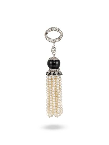 A Diamond, Onyx, Pearl and Platinum Pendant, Circa 1930