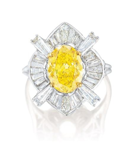 A Fancy Deep Yellow Diamond and Diamond Ring