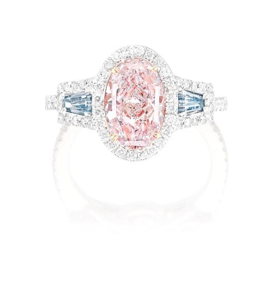 A Light Pink Diamond, Fancy Blue Diamond and Diamond Ring