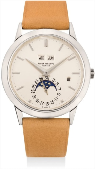 An extremely rare and highly important white gold perpetual calendar wristwatch with moon phases, leap year indicator, original certificate and fitted presentation box