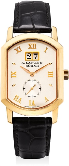 A fine pink gold rectangular wristwatch with date