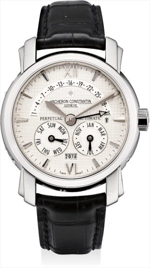 A fine and rare platinum perpetual calendar wristwatch with retrograde date, leap year indicator and digital time display