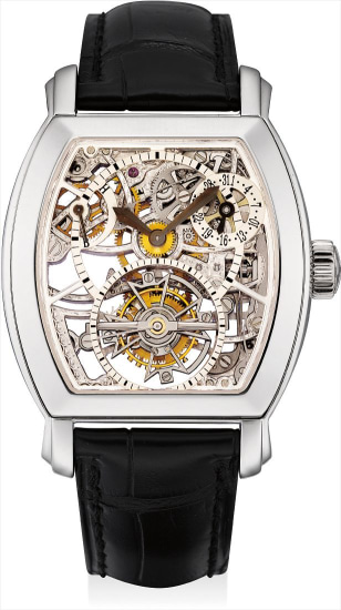 A fine and rare platinum tonneau-shaped skeletonised tourbillon wristwatch with date and power reserve