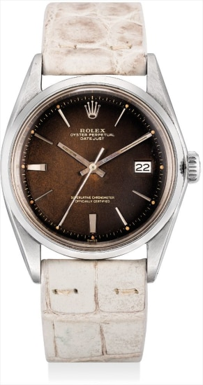 A rare stainless steel and white gold wristwatch with sweep centre seconds, date and 'tropical' lacquer dial