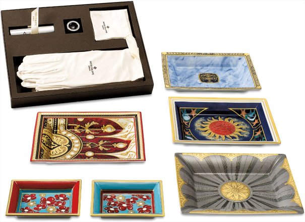 A group of six commemorative limoges porcelain and enamel dishes and a set of watch accessories