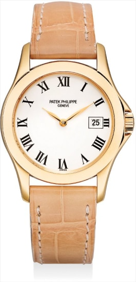 A lady's fine pink gold wristwatch with date