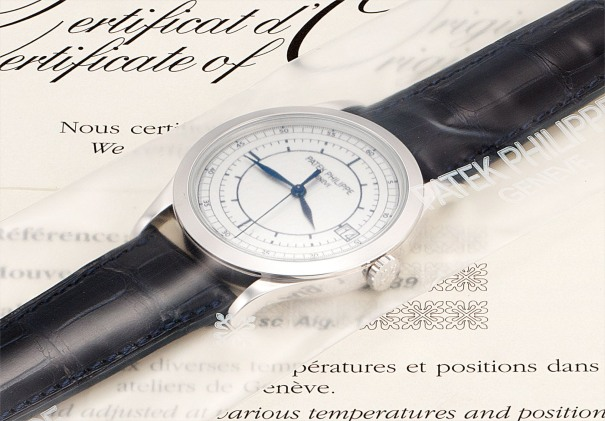 A fine white gold wristwatch with sweep centre seconds, date, two-tone silvered dial, certificate and presentation box, factory sealed