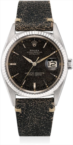 A fine and rare white gold wristwatch with sweep centre seconds, date and 'tropical' dial
