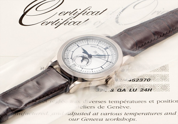 A fine and rare white gold annual calendar wristwatch with sweep centre seconds, 24 hours, moon phases, original certificate and fitted presentation box, factory sealed