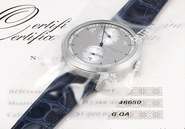 A fine and rare white gold annual calendar wristwatch with regulator-style dial, original certificate and fitted presentation box, factory sealed