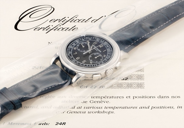 A fine and rare platinum chronograph wristwatch with original certificate and fitted presentation box, factory sealed