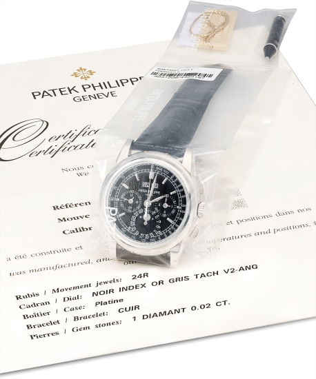 A fine and rare platinum perpetual calendar chronograph wristwatch with 24 hours, leap year indicator, moon phases, additional case back, original certificate and fitted presentation box, factory sealed