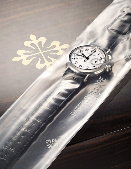 A very fine and very rare platinum split seconds chronograph wristwatch with original certificate and presentation box, factory sealed