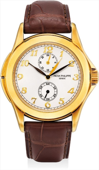 A fine and rare yellow gold dual time wristwatch with 24 hours and Breguet numerals