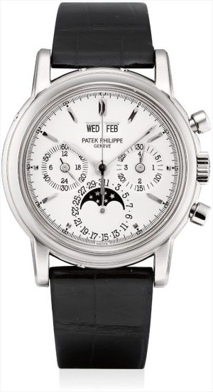 A fine and rare white gold perpetual calendar chronograph wristwatch with moon phases, original certificate and fitted presentation box
