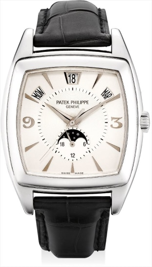 A fine and rare white gold tonneau-shaped annual calendar wristwatch with sweep centre seconds and moon phases
