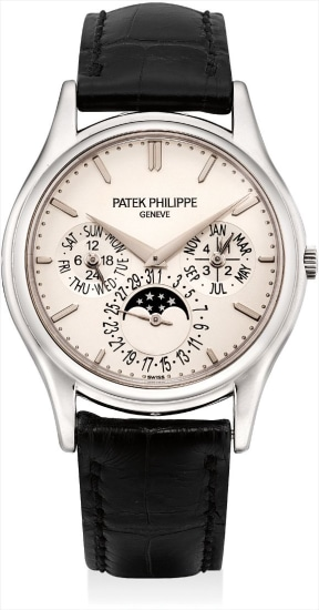 A fine and rare white gold perpetual calendar wristwatch with moon phases, 24 hours, leap year indicator and additional case back