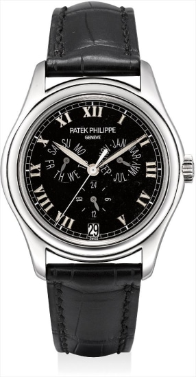 A fine and rare platinum annual calendar wristwatch with sweep centre seconds and 24 hours