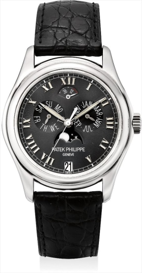 A fine platinum annual calendar wristwatch with sweep centre seconds, power reserve and moon phases