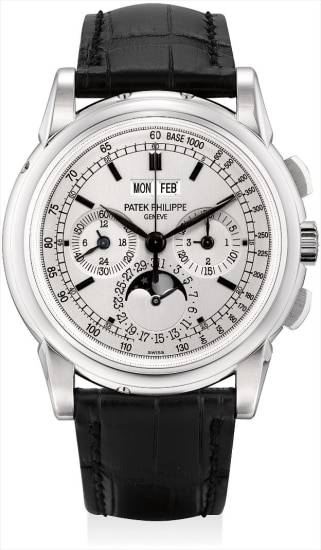 A fine and rare white gold perpetual calendar chronograph wristwatch with 24 hours, leap year indicator, moon phases, original certificate, additional case back and fitted presentation box