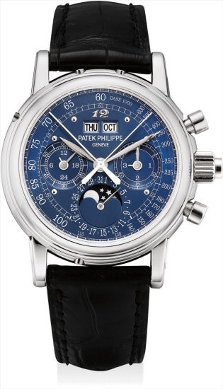 A fine and very rare platinum perpetual calendar split seconds chronograph wristwatch with special blue tachymetre dial, Breguet numeral at 12 o'clock, moon phases, 24 hours, leap year indicator, original certificate, additional case back and fitted presentation box, formerly in the collection of Sir Eric Clapton