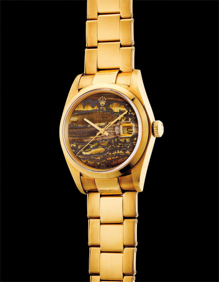 A very fine and very rare yellow gold wristwatch with sweep centre seconds, date, obsidian hardstone dial and bracelet