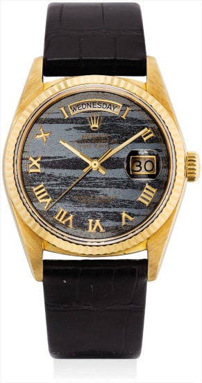 A fine and rare yellow gold calendar wristwatch with sweep centre seconds and ferrite hardstone dial