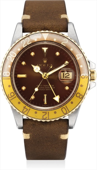 A stainless steel and yellow gold dual time wristwatch with sweep centre seconds and date