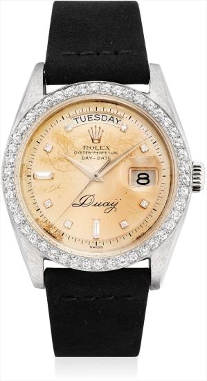 A fine and very rare platinum and diamond-set calendar wristwatch with sweep centre seconds