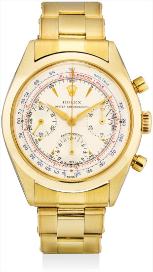 A fine and rare 14k yellow gold chronograph wristwatch with bracelet and fitted presentation box