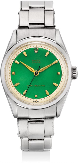 A rare stainless steel wristwatch with sweep centre seconds, green enamel dial, bracelet and fitted presentation box