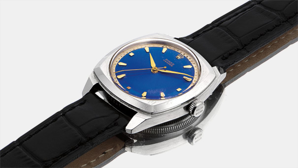 A rare stainless steel cushion-shaped wristwatch with sweep centre seconds and blue enamel dial