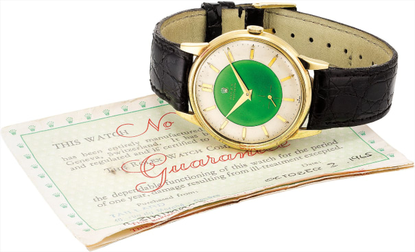 A fine and rare yellow gold wristwatch with sweep centre seconds, green enamel dial, guarantee and fitted presentation box