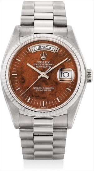 A fine and rare white gold calendar wristwatch with sweep centre seconds, wood dial and bracelet