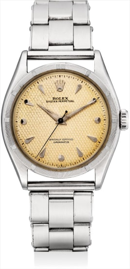A rare stainless steel wristwatch with sweep centre seconds, honey comb dial and bracelet