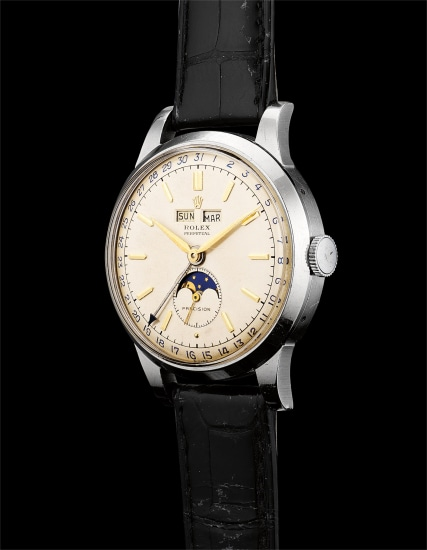 An extremely fine, rare and large stainless steel triple calendar wristwatch with moon phases