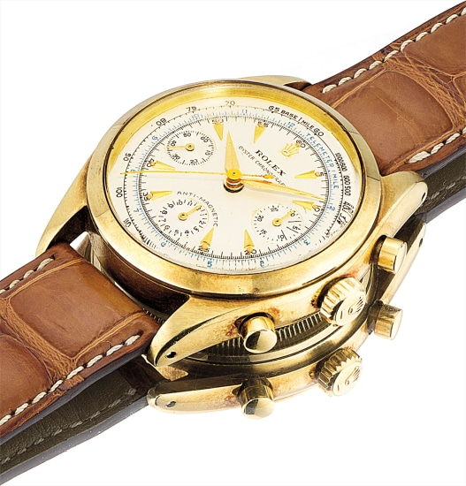 A fine and very rare 14k gold chronograph wristwatch