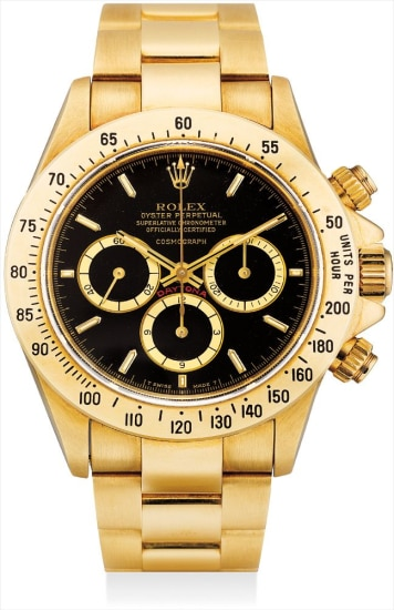 A fine and rare yellow gold chronograph wristwatch with suspended logo and bracelet