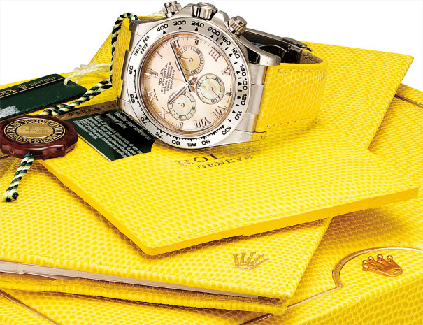 A fine and rare white gold chronograph wristwatch with yellow mother-of-pearl dial, guarantee, fitted presentation box and outer packaging