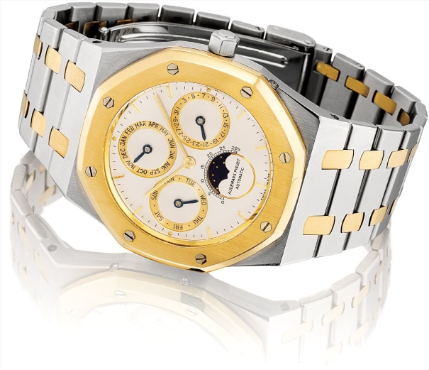 A very rare stainless steel and yellow gold perpetual calendar wristwatch with moon phases and bracelet