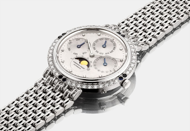 A fine and rare white gold, diamond and sapphire-set perpetual calendar bracelet watch with moon phases
